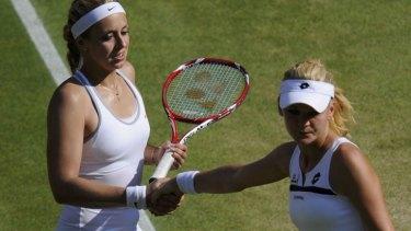 Agnieszka Radwanska, right  shakes the hand of Germany's Sabine Lisicki after Radwanska's defeat in their women's semi-final at Wimbledon.