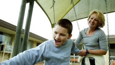 Bernadette Moloney pictured in 2004 with her son Charley at Kingsdene School, which is earmarked for closure if funding cannot be found.