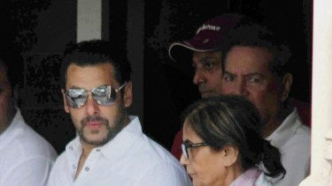 Salman Khan walks with his mother as he leaves home for court in Mumbai.