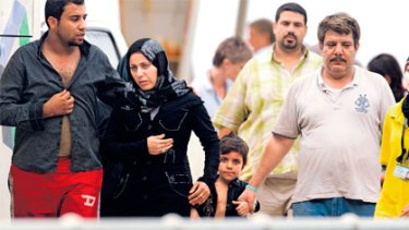 Intercepted asylum seekers arrive at Christmas Island in mid-April.
