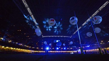 Air balls: Inflatables display the 14 competing nations at the opening ceremony in Cardiff.