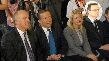 Video Still of Tony Abbott  with Alastair Furnival (highlighted) at the Cadbury Factory.