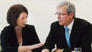 No hard feelings... Prime Minister Julia Gillard chats with the man she deposed, Kevin Rudd.
