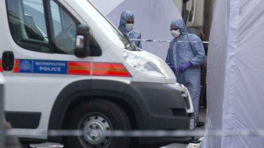 """Shocking death: forensic officers attend the scene."