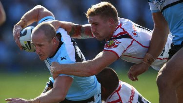 Sharks halfback Jeff Robson tries to break free of the Warriors.