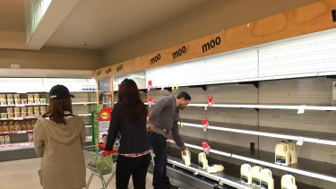 Coles at Chadstone with empty milk shelves.