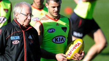 Dr. Bruce Reid with Brent Stanton at Essendon training in June.