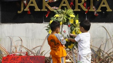 Children at a makeshift memorial outside the Ritz-Carlton hotel.