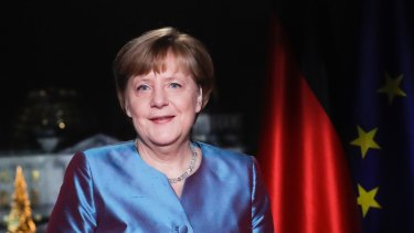 German Chancellor Angela Merkel poses for photographs after the television recording of her annual New Year's speech.