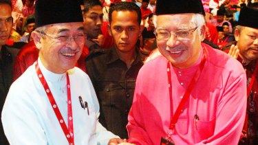 Abdullah Ahmad Badawi and Najib Razak.