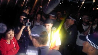 Police speak to Occupy Sydney protesters in Hyde Park tonight.