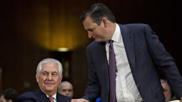 Senator Ted Cruz, a Republican from Texas, right, shakes hands with Rex Tillerson during his testimony.
