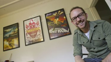 Designer Jeremy Saunders with his posters for The Motorcycle Diaries, Tarnation and Suburban Mayhem.