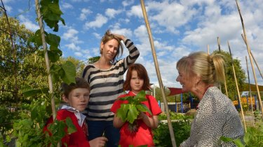 School parent Lauren Richardson (left) and Kingsville Primary School students Zoe Brown and Patrick Manning discuss horticulture with deputy principal Carolyn Withers.