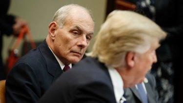 US Homeland Security Secretary John Kelly listens as President Donald Trump speaks in the Roosevelt Room of the White House.