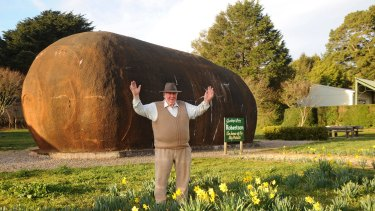Big Potato builder Jim Mauger with the iconic landmark, which is now up for sale.