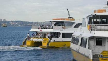 Ferry land ... a Sydney Ferries vessel is in the background as the Manly Fast Ferry (centre) and Sydney Fast Ferries services head off from Manly Wharf yesterday.