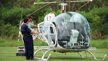 Police examine the helicopter used in the brazen jail escape by John Killick in 1999.