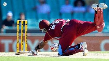 West Indies batsman Kieron Pollard dives to make his ground.
