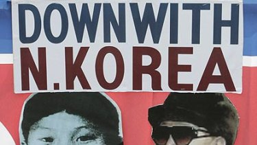 Kim Jong Il, pictured right on this poster, has appointed Kim Jong Un, left, as head of North Korea's spy agency.