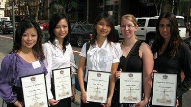 Brisbane international student ambassadors Echo Shan Zhao (China), Xiaoyan Xiong (China), Tung Hin Wong (Hong Kong), Judith Radicke (Germany) and Patricia Rodriguez (Brazil).