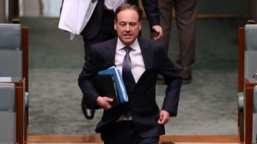Environment minister Greg Hunt runs to his seat ahead of question time on Wednesday.