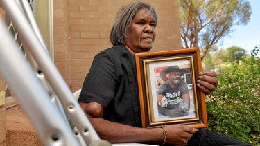 """They can't just do what they did and forget about it"": Therese Ryder with a portrait of her son Kwementyaye."
