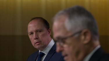 Malcolm Turnbull and Immigration Minister Peter Dutton announce changes to refugee immigration.