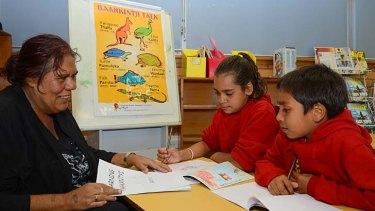 Talk time: Kayleen Kerwin tutors Sammarah Lea Edge, 10, and Shakur Johnson, 8, in Paakantyi.