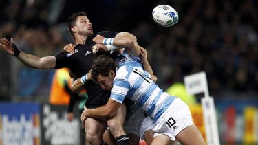 Miracle ball ... Cory Jane's pass led to Brad Thorn's try for New Zealand.