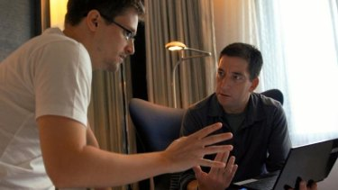 Edward Snowden talks with journalist Glenn Greenwald in a scene from the documentary <i>Citizenfour</i>.