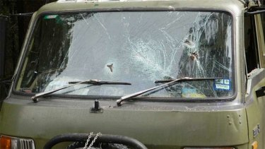 A star-picket was used to smash the windscreen and passenger window of the protester's truck.