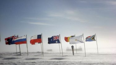 Flags of the signatories to the Antarctica Treaty flutter at the South Pole, first visited a century ago.