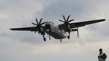 A file photo of a US Navy C-2 Greyhound aircraft. Japan's defense minister indicated that the plane might have had engine trouble.