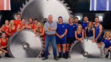 Challenge: Scott Cam, centre, host of Channel Nine's new reality show Reno Rumble, with the two teams of contestants.