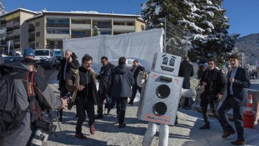 A person in a robot costume at the World Economic Forum in Davos in January promoted this weekend's basic income referendum in Switzerland