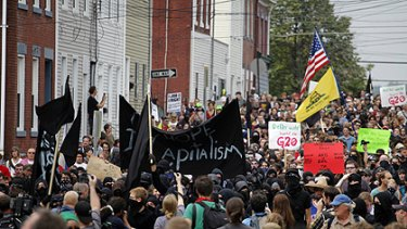 Demonstrators march in Pittsburgh before the start of the US city's G20 summit.