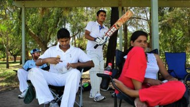 Team spirit ... from left, Brad Watts, Sabharinath Dhillon, Sohan Singh and Manider Kaur at a Churches Cricket Association match.