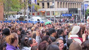 Mayhem ... fans flock to see One Direction in Sydney today.