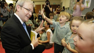 Start talking: Prime Minister Kevin Rudd meets the children at the Australian International School in Singapore yesterday and urges them to learn a regional language.