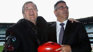 Rock on ... AFL boss Andrew Demetriou with Meat Loaf before the grand final.