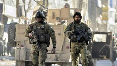 Controversial photo ...  an unidentified SAS soldier with Victoria Cross winner Willie Apiata in Kabul.