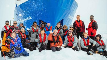 A longer trip than they thought: Passengers on the Akademik Shokalskiy gather on the ice.