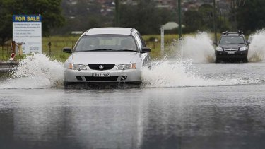 Wild weather: Flooding over summer can be attributed to an increase in the accumulation of greenhouse gasses in the atmosphere, report says.