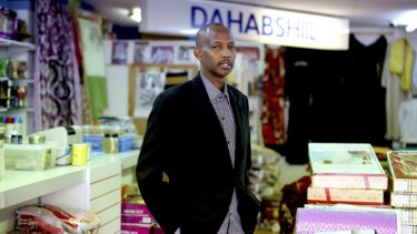 Abdirahman Mohamud, a father of nine,runs a convenience store in Moorooka, but has also joined Australian peacekeepers in Somalia as a translator during Operation Solace.