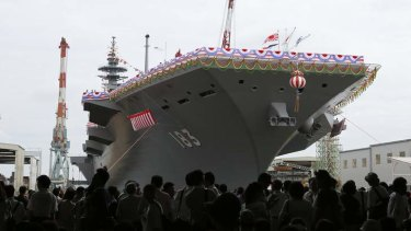 Japan Maritime Self-Defence Force's helicopter destroyer DDH183 Izumo at its launch in Yokohama.
