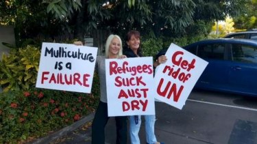 Strong views ... Vuga, left, and a friend with placards for their 'counter-protest'.