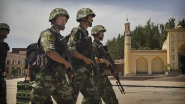 Chinese soldiers patrol outside the Id Kah mosque in Kashgar, in the far western region of Xinjiang.
