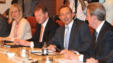 ACT Chief Minister Katy Gallagher, Dr Ian Watt, Secretary of Prime Minister and Cabinet, Prime Minister Tony Abbott and NSW Premier Barry O'Farrell, during the COAG meeting.