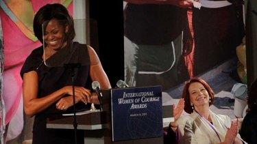 Michelle Obama, left, pictured with Australia Prime Minister Julia Gillard.